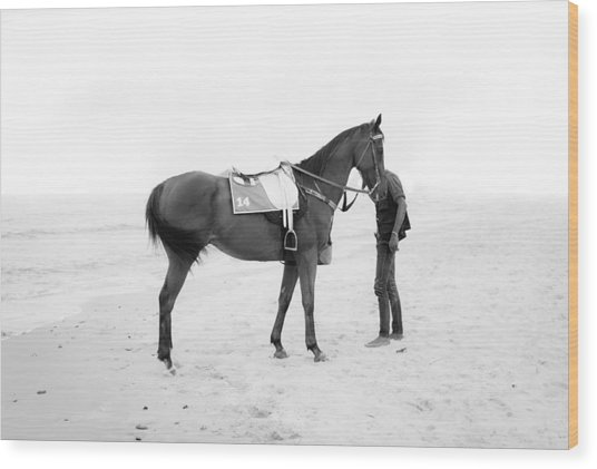 Horse And Man On The Beach Black And White Wood Print by Kittipan Boonsopit