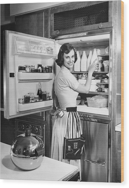 House Wife Removing Milk From Refrigerator Wood Print by George Marks