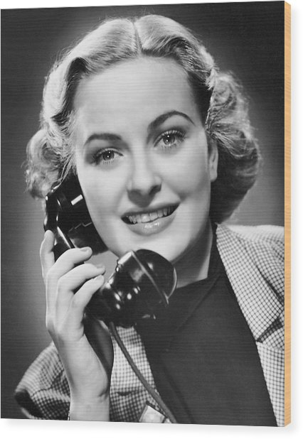 Indoor Portrait Of Woman On Telephone Wood Print by George Marks