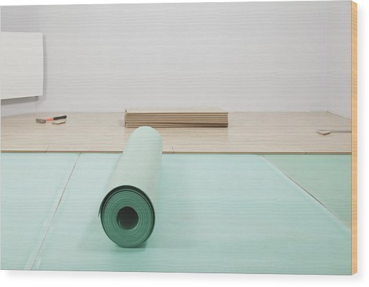 Laying A Floor. A Roll Of Underlay Or Wood Print by Magomed Magomedagaev