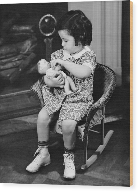 Little Girl Playing With Doll Wood Print by George Marks