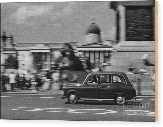 London Cab In Trafalgar Square Wood Print by Aldo Cervato