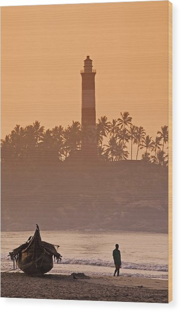 Lone Person Walking Along Lighthouse Beach In Early Morning Wood Print by Anders Blomqvist