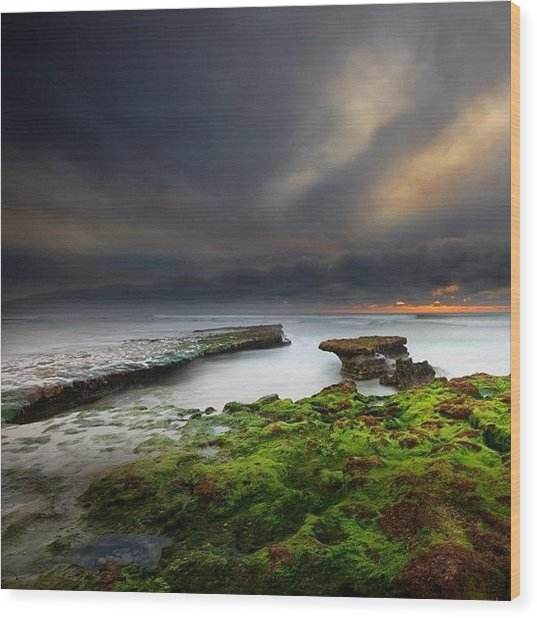Long Exposure Of A Stormy Sunset At A Wood Print by Larry Marshall