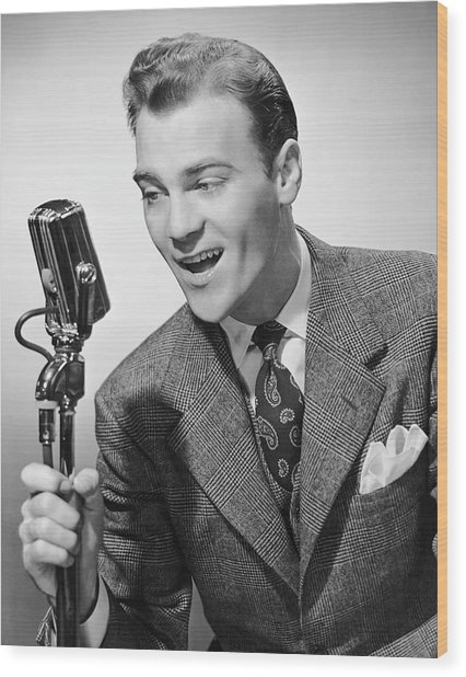 Male Singer Holding Microphone Wood Print by George Marks