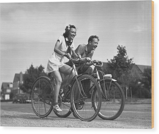 Man And Woman Riding Bicycles, (b&w), Wood Print by George Marks