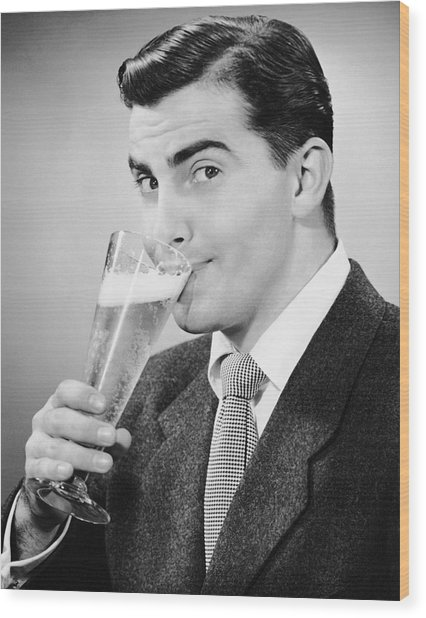 Man In Suit Drinking Tall Glass Of Beer Wood Print by George Marks