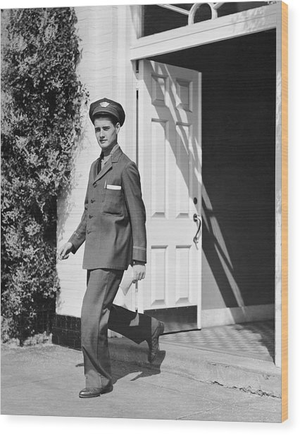 Man In Uniform Walking Out Door Wood Print by George Marks