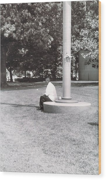 Man Resting At Pole Wood Print by Floyd Smith