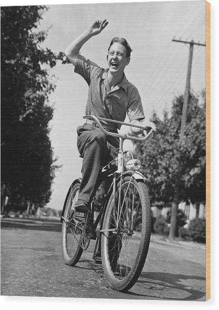 Man Riding Bicycle, Waving, (b&w) Wood Print by George Marks