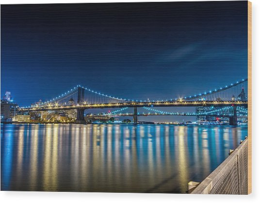 Manhattan Bridge And Light Reflections In East River. Wood Print