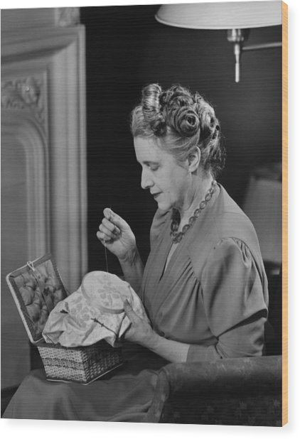 Mature Woman Sitting In Living Room, Doing Needlepoint, (b&w) Wood Print by George Marks