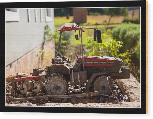 Model Tractor Wood Print by Miguel Capelo