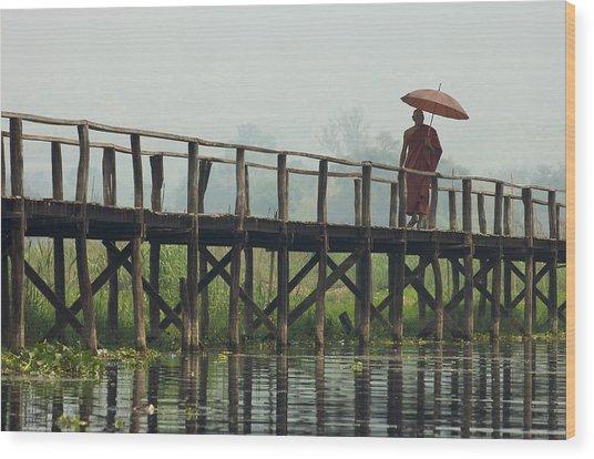 Monk Crosses A Bridge On The Eastern Shore Town Wood Print by David Greedy