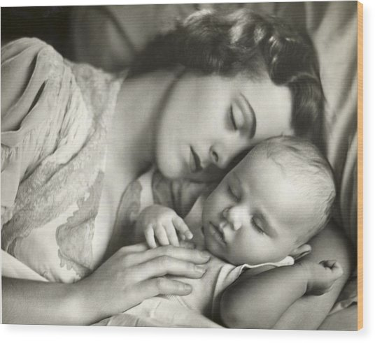 Mother Holding Infant In Bed Wood Print by George Marks