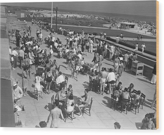 People Sitting At Tables By Beach, (b&w), Elevated View Wood Print by George Marks