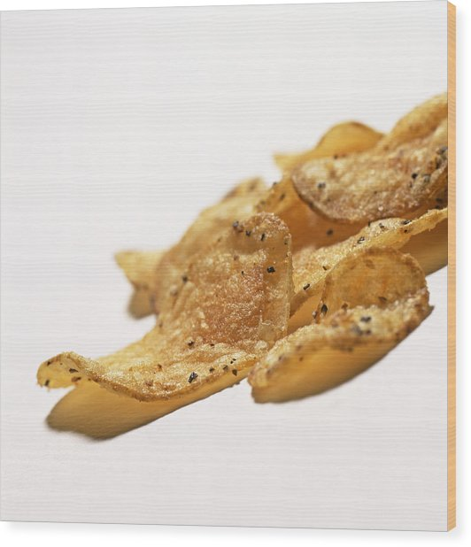 Peppered Crisps Wood Print by Kevin Curtis