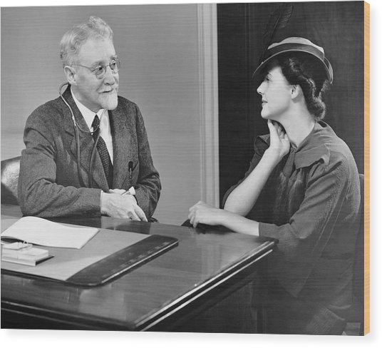 Physician Talking To Patient Wood Print by George Marks