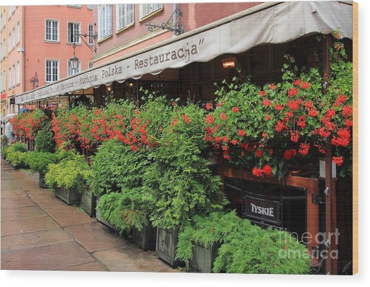 picturesque restaurant terrace in Gdansk Poland Wood Print by Sophie Vigneault