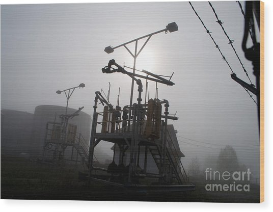 Platforms And Tanks At Petrocor In The Fog Wood Print by Gary Chapple