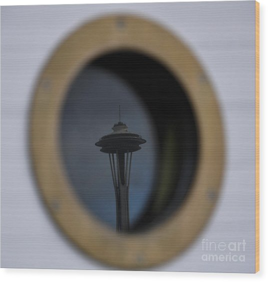 Port Hole Reflection Of The Space Needle Wood Print by Camille Lyver