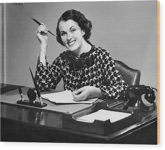 Portrait Of Businesswoman At Desk Wood Print by George Marks