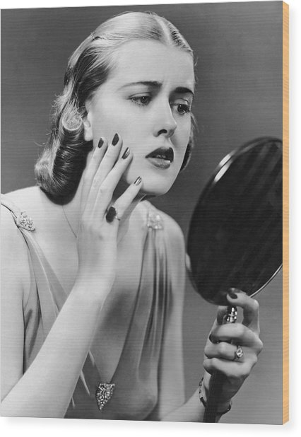 Portrait Of Upset Woman Looking In Hand Mirror Wood Print by George Marks