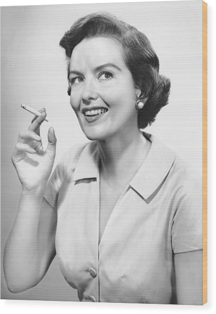 Portrait Of Woman Holding Cigarettte Wood Print by George Marks