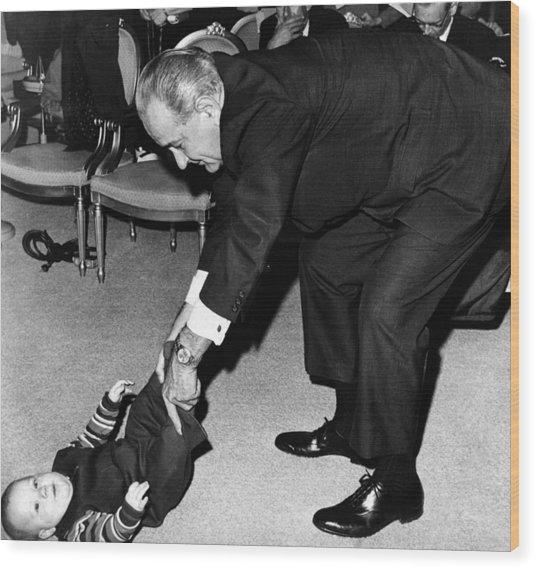 President Lyndon Johnson Tugs The Legs Wood Print by Everett