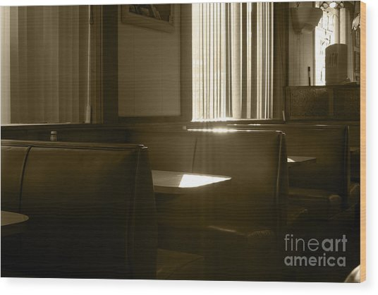Restaurant Booth With Streaming Sunlight In Sepia Wood Print