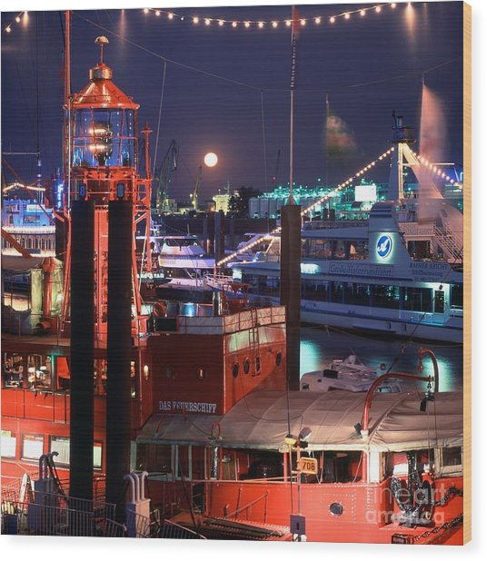 Rising Moon Over Lightship Wood Print by Serge Fourletoff