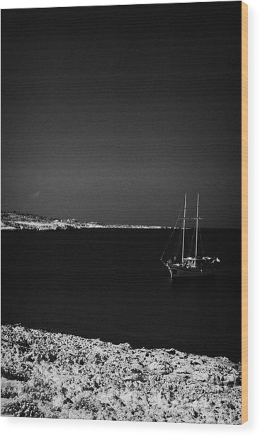 Sailing Boat Moored In A Quiet Bay Near Cape Gkreko Greco Republic Of Cyprus Wood Print by Joe Fox