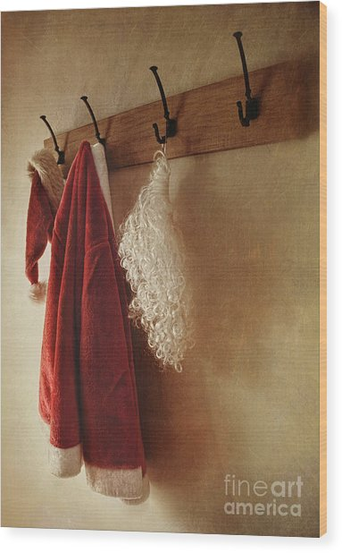 Santa Costume Hanging On Coat Rack Wood Print