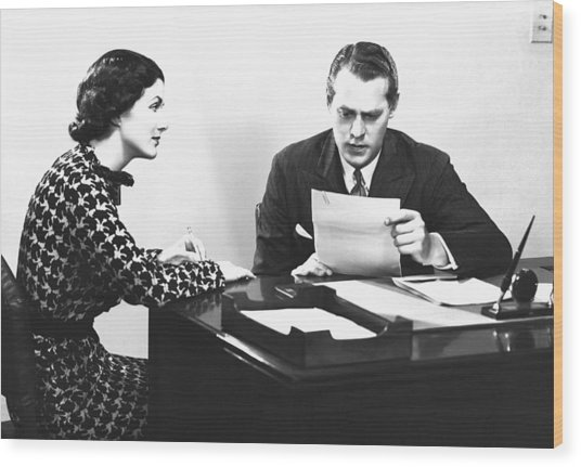 Secretary Assisting Businessman Reading Document At Desk, (b&w) Wood Print by George Marks