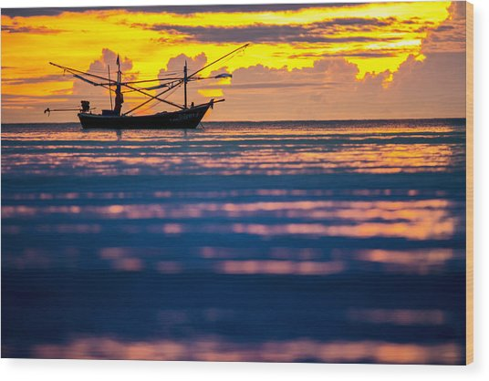 Silhouette Boat At Sea Wood Print by Arthit Somsakul