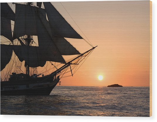 Silhouette Of Tall Ship At Sunset Wood Print
