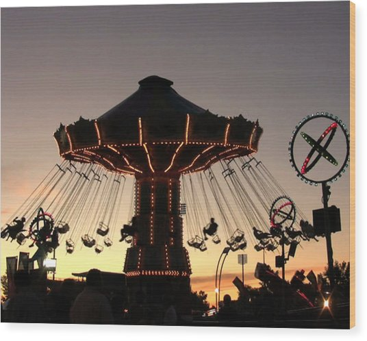 Silhouetted Amusement Ride Wood Print by Kim French