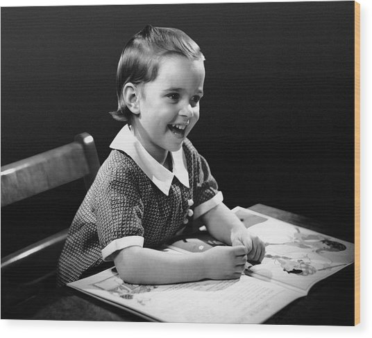 Smiling Young Girl Reading Book Wood Print by George Marks