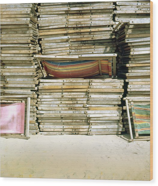Stacked Deckchairs On Beach Wood Print by Daniel Blatt