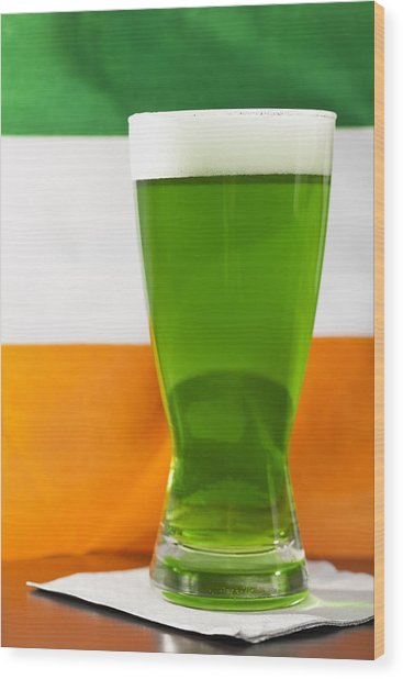 Studio Shot Of Glass Of Green Beer With Irish Flag Wood Print