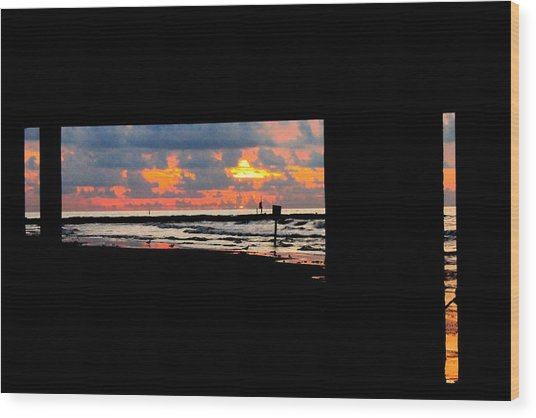 Sun Rise From Under The Pier Wood Print by Mark Longtin