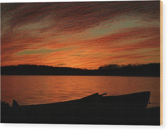 Sunset And Kayak Wood Print