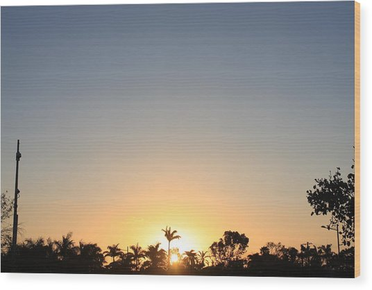 Sunset In Paradise Wood Print by Nicholas Lowcock