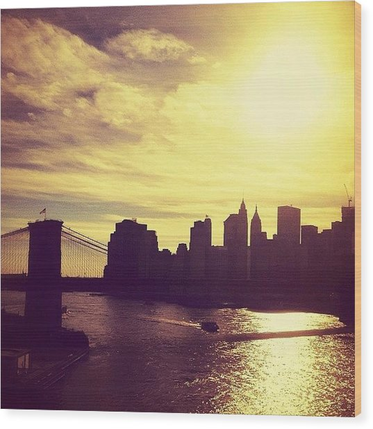 Sunset Over The New York City Skyline And The Brooklyn Bridge Wood Print