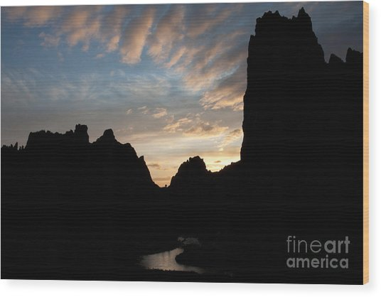 Sunset With Rugged Cliffs In Silhouette Wood Print