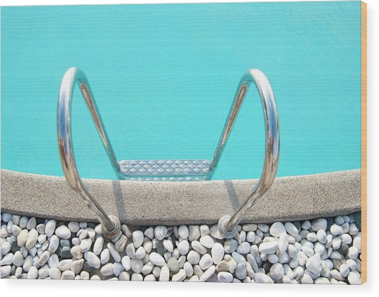 Swimming Pool With White Pebbles Wood Print by Lawren