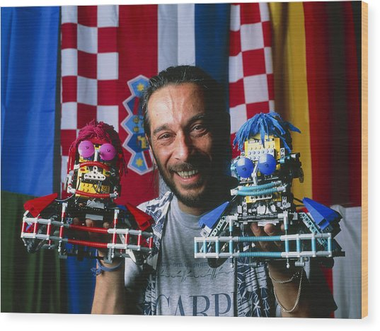 Technician With Lego Footballers At Robocup-98 Wood Print by Volker Steger