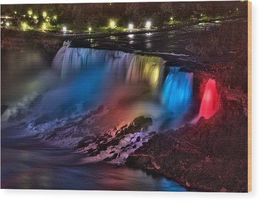 The American Falls Illuminated With Colors Wood Print
