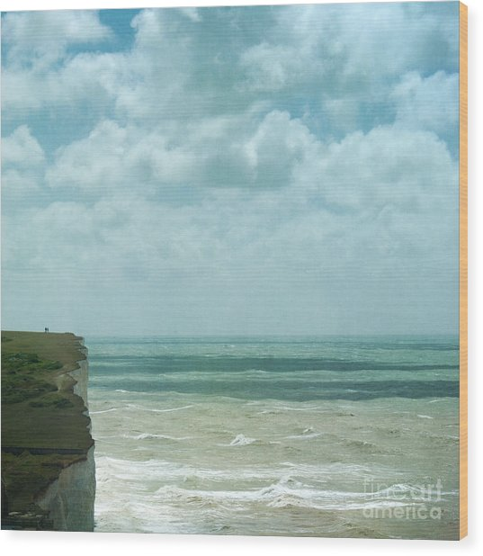The Waves Bellow Us Wood Print by Paul Grand