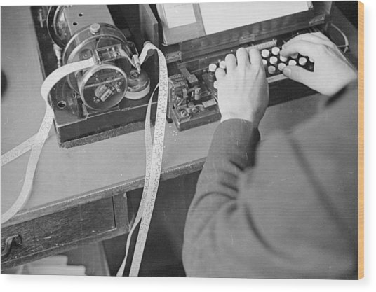 Ticker Tape Typing Wood Print by Fox Photos